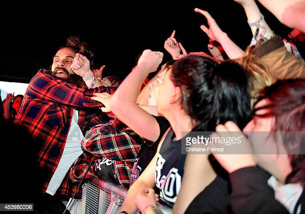 Jason Aalon Butler of Letlive performs on Day 1 of the Leeds Festival at Bramham Park on August 22 2014 in Leeds England