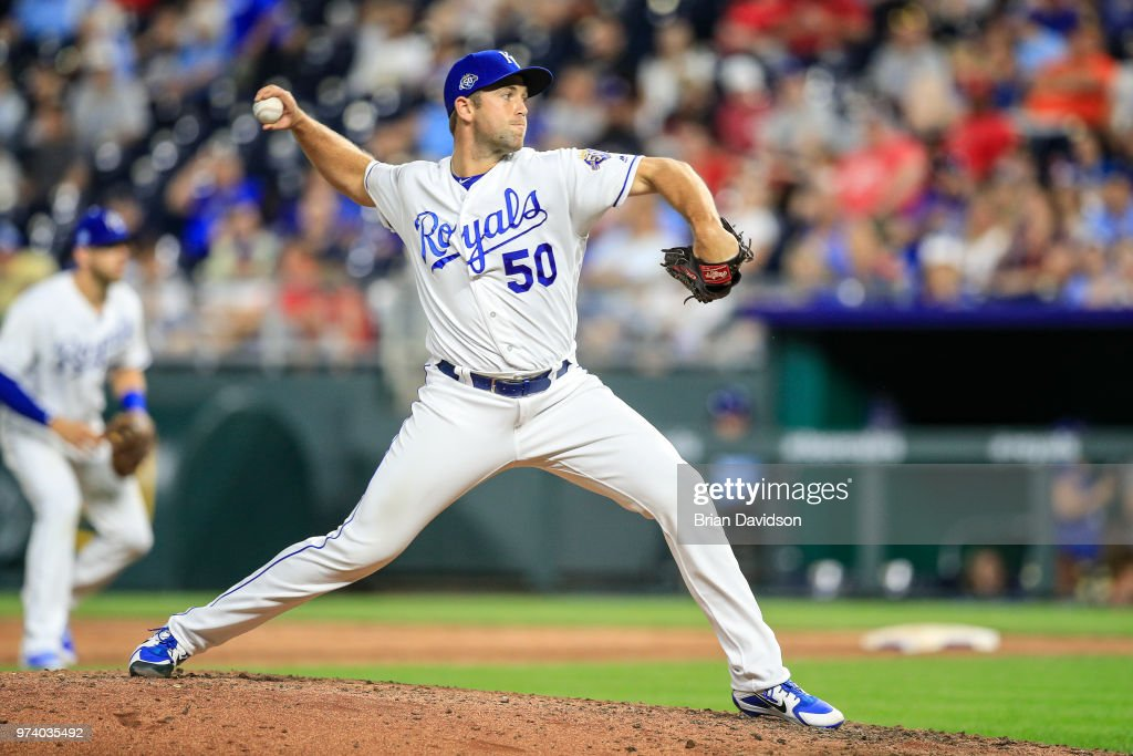 Jason Adam #50 of the Kansas City Royals pitches during the ninth inning against the Cincinnati Reds at Kauffman Stadium on June 13, 2018 in Kansas City, Missouri.