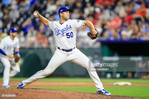 Jason Adam of the Kansas City Royals pitches during the ninth inning against the Cincinnati Reds at Kauffman Stadium on June 13 2018 in Kansas City...