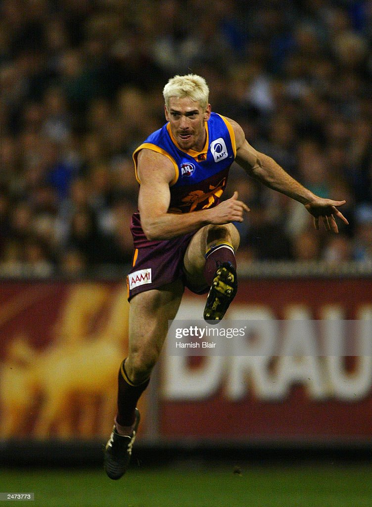 Jason Akermanis #12 for Brisbane in action during the AFL Second Qualifying Final between the Collingwood Magpies and the Brisbane Lions at the Melbourne Cricket Ground on September 6, 2003 in Melbourne, Australia.