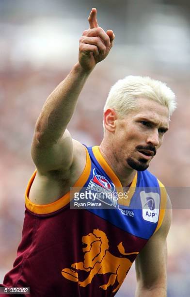 Jason Akermanis for the Brisbane Lions celebrates a goal during the AFL Grand Final against the Port Adelaide Power at the Melbourne Cricket Ground...