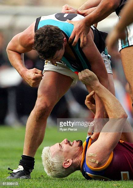 Jason Akermanis for the Lions clashes with Josh Carr for the Power during the AFL Grand Final between the Port Adelaide Power and the Brisbane Lions...