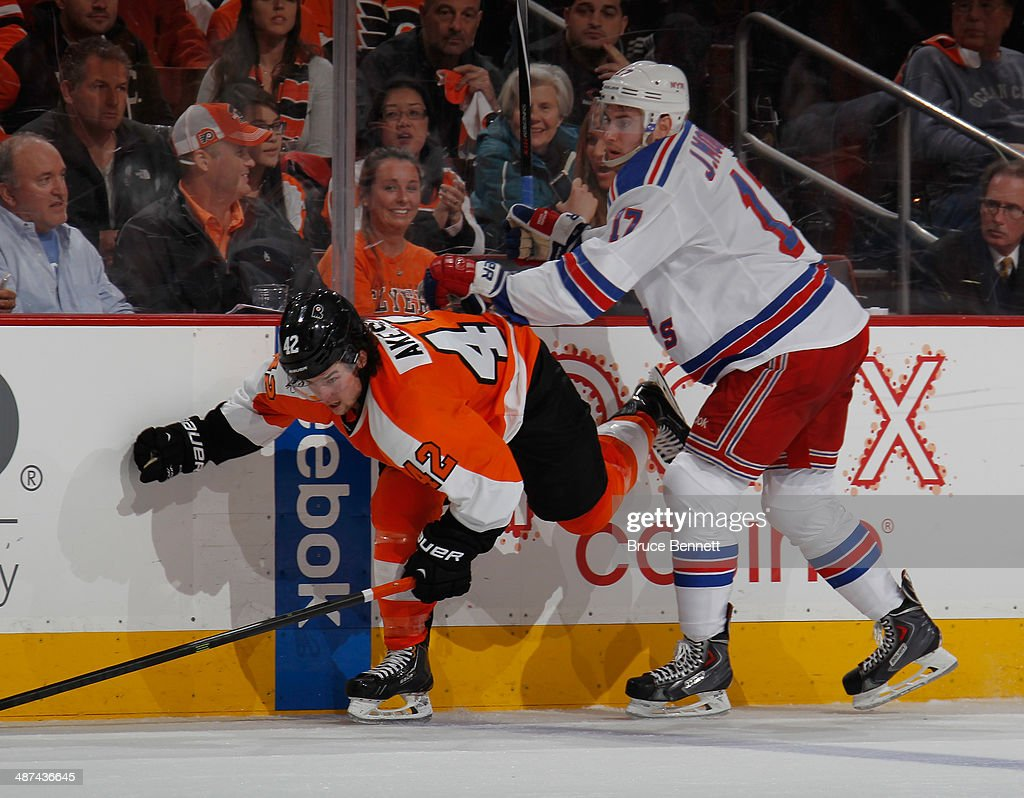 Jason Akeson #42 of the Philadelphia Flyers is hit by John Moore #17 of the New York Rangers in Game Six of the First Round of the 2014 NHL Stanley Cup Playoffs at the Wells Fargo Center on April 29, 2014 in Philadelphia, Pennsylvania.