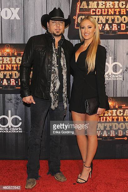 Jason Aldean and Brittany Kerr attend the 2014 American Country Countdown Awards at Music City Center on December 15 2014 in Nashville Tennessee