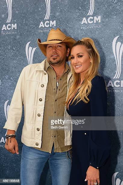 Jason Aldean and his wife Brittany Kerr attend the 9th Annual ACM Honors at Ryman Auditorium on September 1 2015 in Nashville Tennessee