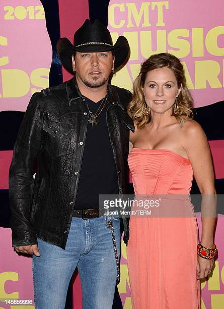 Jason Aldean and Jessica Aldean arrive at the 2012 CMT Music awards at the Bridgestone Arena on June 6 2012 in Nashville Tennessee