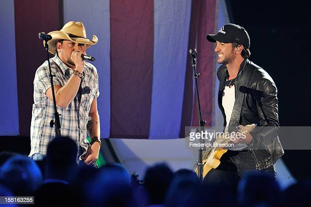 Jason Aldean and Luke Bryan perform during the 46th annual CMA awards at the Bridgestone Arena on November 1, 2012 in Nashville, Tennessee.