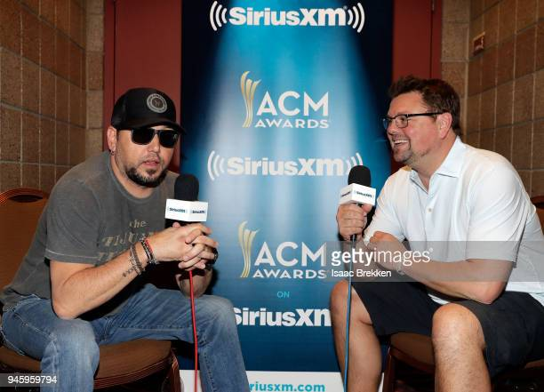 Jason Aldean and Storme Warren attend SiriusXM's The Highway channel broadcast backstage from the Academy of Country Music Awards on April 13 2018 in...