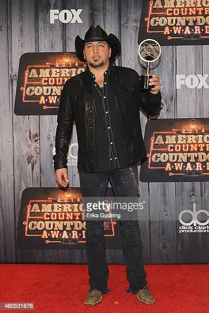 Jason Aldean Artist of the Year award winner poses in the press room during the 2014 American Country Countdown Awards at Music City Center on...