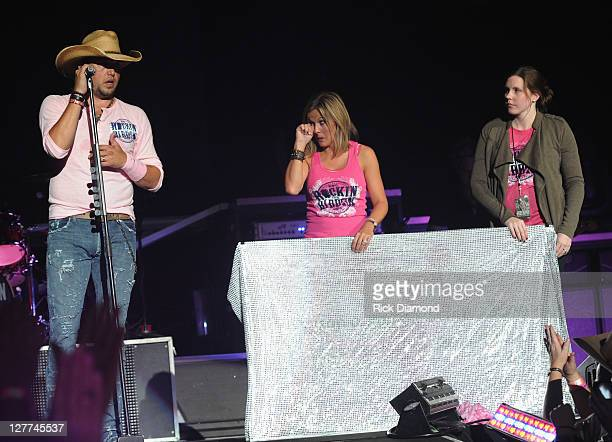 Jason Aldean Jess Aldean and Guest display chech raising over 300 thousand dollars to be donated to the local chapter of the Susan G Koman foundation...