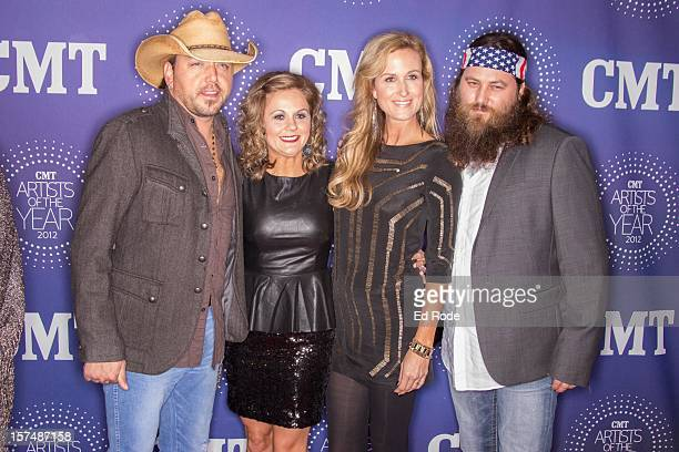 Jason Aldean Jessica Aldean Korie Robertson and Willie Robertson attend the CMT Artist of the Year Awards at The Factory At Franklin on December 3...