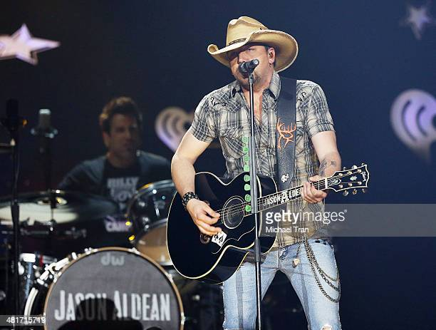 Jason Aldean performs onstage during iHeartRadio Country Festival in Austin at the Frank Erwin Center on March 29 2014 in Austin Texas