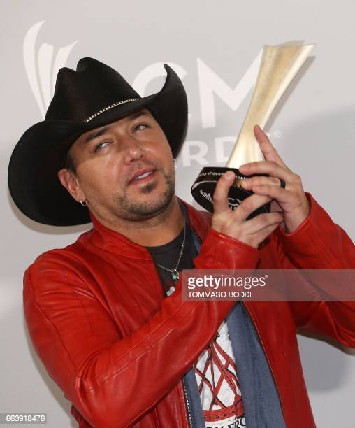Jason Aldean poses with the Entertainer of the Year award in the press room of the 52nd Academy of Country Music Awards on April 2 at the TMobile...