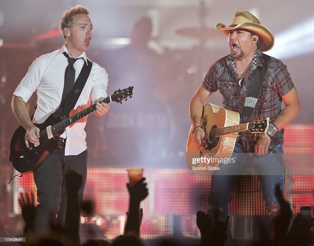Jason Aldean, right, and guitarist Kurt Allison perform at Fenway Park on Friday, July 12, 2013.