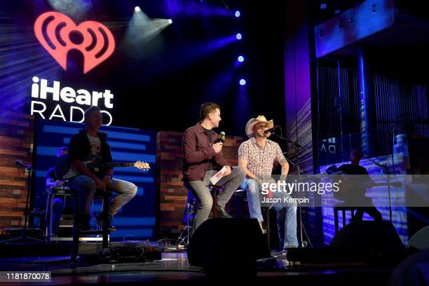 Jason Aldean speaks with host ScottyMcCreeryon stage during iHeartCountryOneNightForOurMilitary Presented by Rocheat the Country Music Hall...