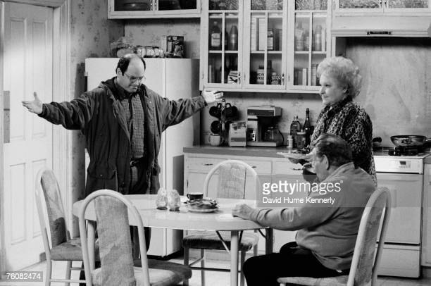 "Jason Alexander as ""George"" with co-stars Estelle Harris and Jerry Stiller on the set of Seinfeld during the final days of shooting on April 3, 1998..."