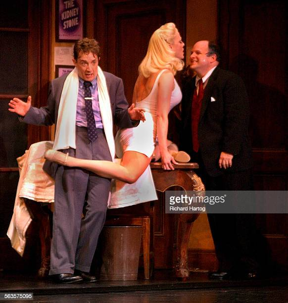 Jason Alexander as Max Bialystock right and Martin Short as Leo Bloom left with Ulla center during a scene from The Producers at the Panatges Theatre...