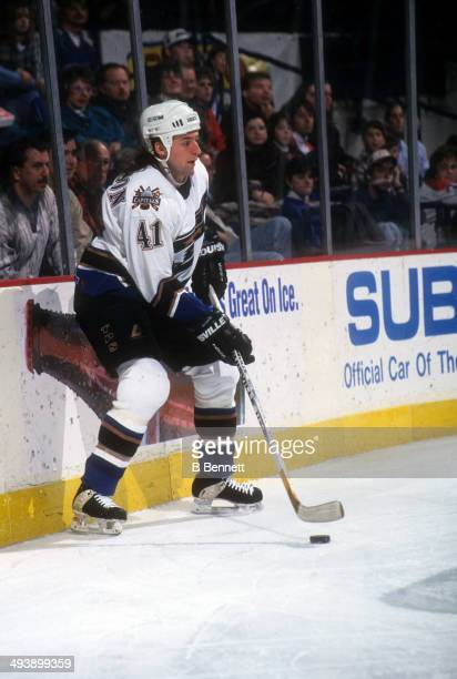 Jason Allison of the Washington Capitals holds the puck behind the net during an NHL game in January 1996 at the USAir Arena in Landover Maryland