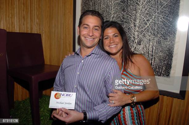 Jason and Lecey Port pose with Michael Jordan chair they won at auction of chairs signed by celebrities to benefit Miami Children's Hospital at Nobu...