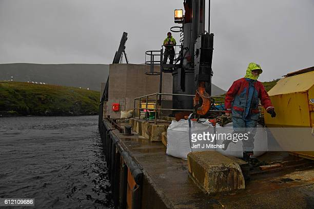 Jason and Stuart Taylor work the crain on the jetty on the Island of Foula on September 29, 2016 in Foula, Scotland. Foula is the remotest inhabited...