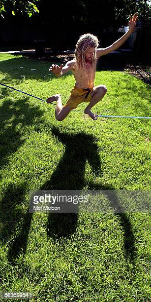 Jason Andrews of Ojai, keeps his balance while walking a tightrope that he rigged up between 2 trees a Libbey Park in Ojai. Andrews, who is a rock...