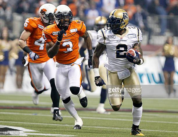 Jason Arakgi and Cauchy Muamba of the BC Lions pursue punt returner Jovon Johnson of the Winnipeg Blue Bombers during the CFL 99th Grey Cup November...
