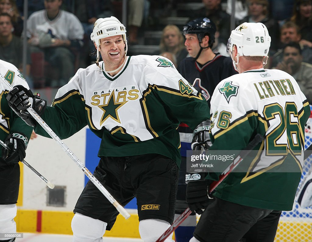 Jason Arnott #44 of the Dallas Stars congratulates teammate Jere Lehtinen #26 on scoring against the Vancouver Canucks in the second period at General Motors Place on October 16, 2005 in Vancouver, Canada. The Canucks defeated the Stars 5-2.