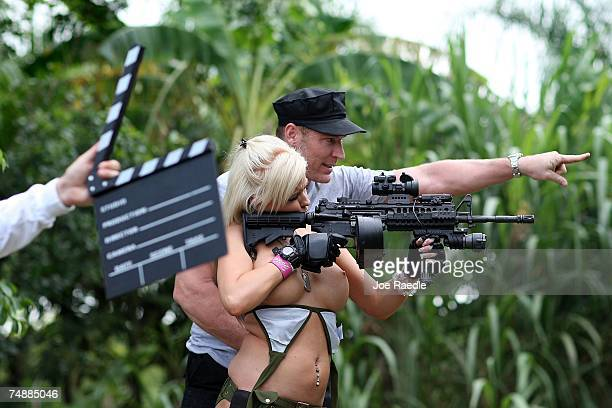 Jason Atkins creator/producer shows Andrea Brooke Ownbey the target she should shoot at on the set of Girls and Guns a webbased reality show...