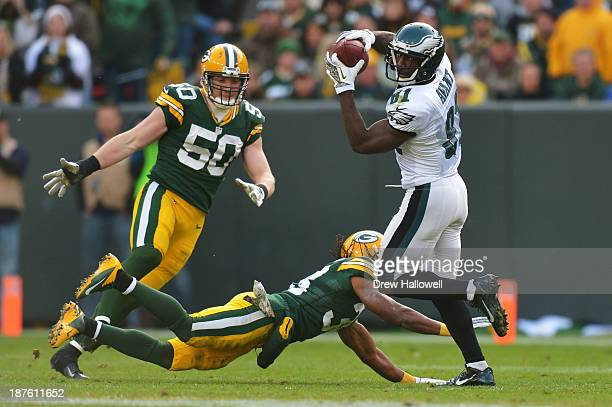Jason Avant of the Philadelphia Eagles catches a pass in front of and Tramon Williams of the Green Bay Packers at Lambeau Field on November 10 2013...