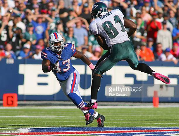 Jason Avant of the Philadelphia Eagles goes up to make a catch against Bryan Scott of the Buffalo Bills at Ralph Wilson Stadium on October 9, 2011 in...