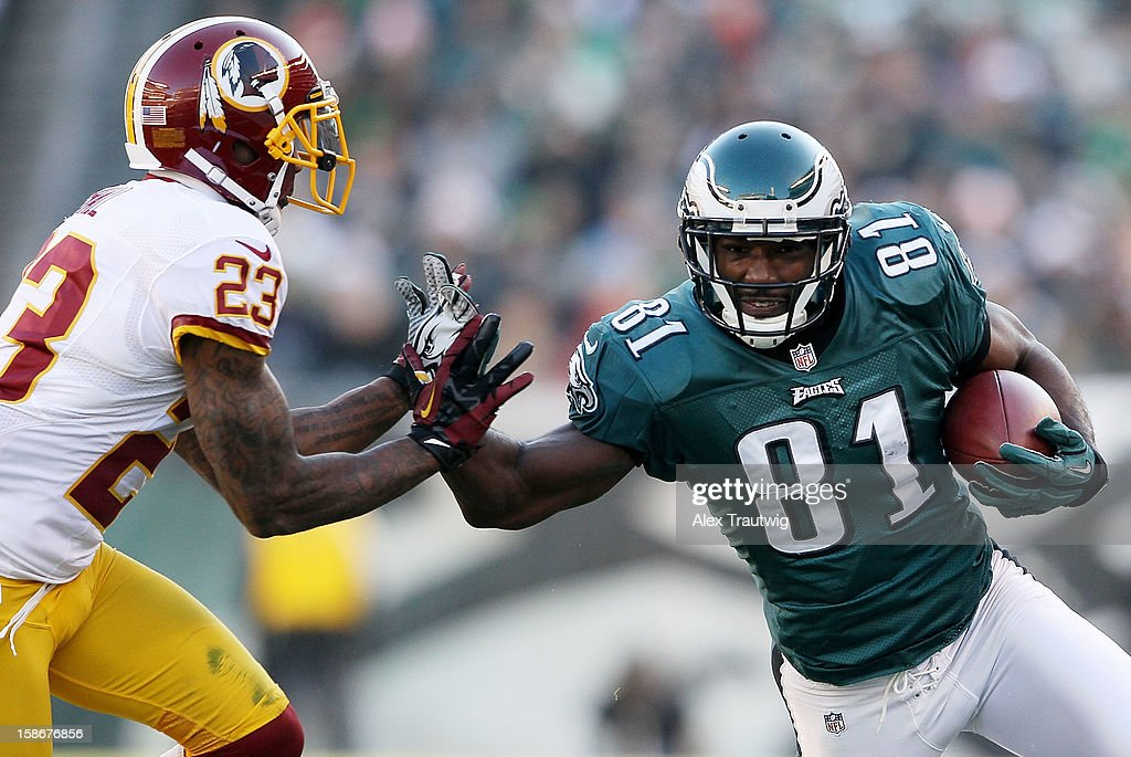 Jason Avant #81 of the Philadelphia Eagles runs with the ball as DeAngelo Hall #23 of the Washington Redskins defends at Lincoln Financial Field on December 23, 2012 in Philadelphia, Pennsylvania.