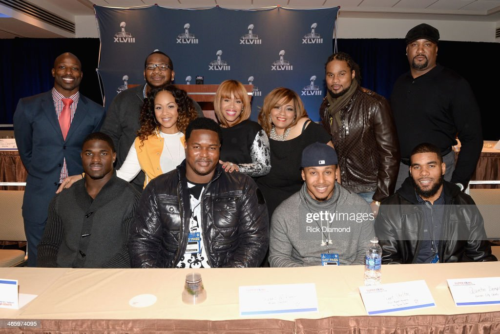 Jason Avant, Terrence Stephens, Erica Campbell, Tina Campbell, Melanie Few-Harrison, Josh Cribbs, Keith Hamilton, (Bottom L-R) Victor Aiyewa, Bryant McKinnie, Trent Shelton, and Quintin Demps attend the Super Bowl Gospel Celebration press conference at Super Bowl XLVIII Media Center, Sheraton Times Square on January 30, 2014 in New York City.