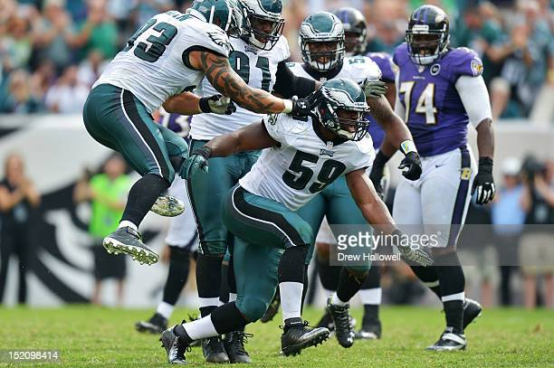 Jason Babin and DeMeco Ryans of the Philadelphia Eagles celebrate a sack during the game against the Baltimore Ravens at Lincoln Financial Field on...