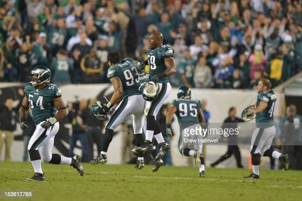 Jason Babin and DeMeco Ryans of the Philadelphia Eagles celebrate during the game against the New York Giants at Lincoln Financial Field on September...