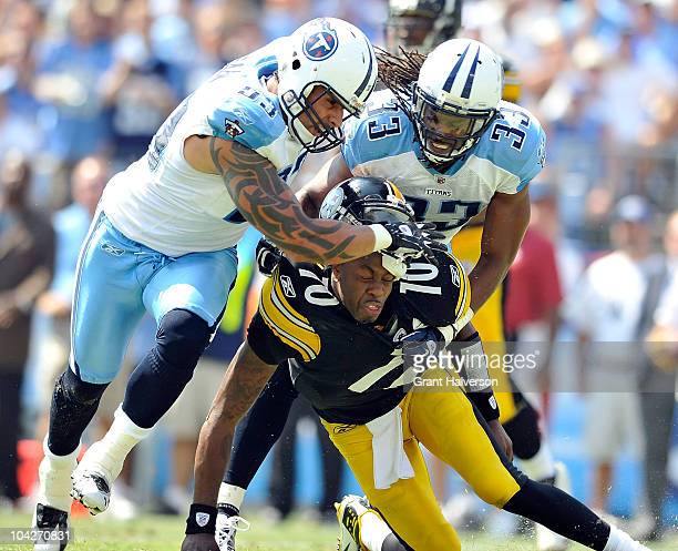 Jason Babin and Michael Griffin of the Tennessee Titans pressure quarterback Dennis Dixon of the Pittsburgh Steelers during the first half at LP...