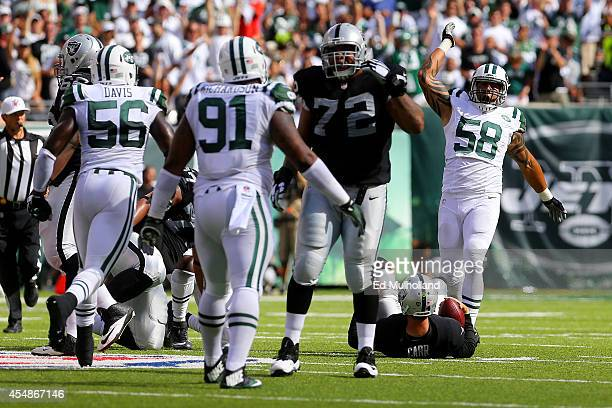 Jason Babin of the New York Jets celebrates sacking Derek Carr of the Oakland Raiders during the fourth quarter at MetLife Stadium on September 7...