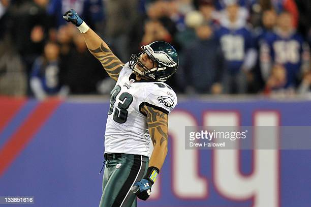 Jason Babin of the Philadelphia Eagles celebrates a sack for a forced fumble in the fourth quarter during the game against the New York Giants at...