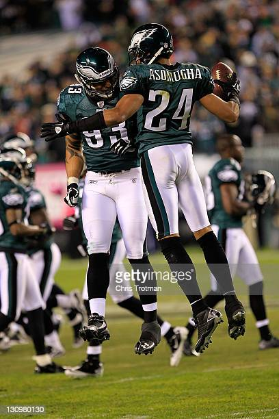 Jason Babin of the Philadelphia Eagles chest bumps his teammate Nnamdi Asomugha against the Dallas Cowboys at Lincoln Financial Field on October 30...