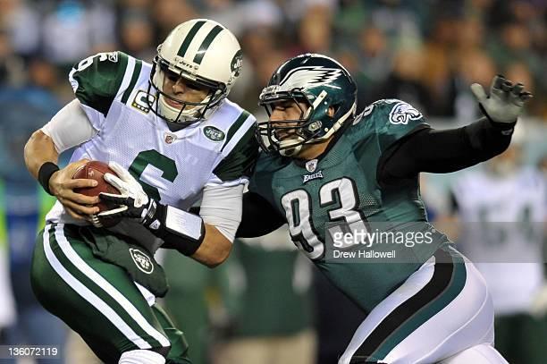 Jason Babin of the Philadelphia Eagles sacks Mark Sanchez of the New York Jets at Lincoln Financial Field on December 18 2011 in Philadelphia...