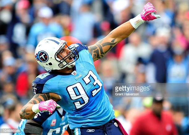 Jason Babin of the Tennessee Titans celebrates after sacking quarterback Kyle Orton of the Denver Broncos during the first half at LP Field on...