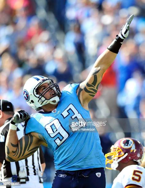 Jason Babin of the Tennessee Titans reacts after sacking quarterback Donovan McNabb of the Washington Redskins during the first half at LP Field on...