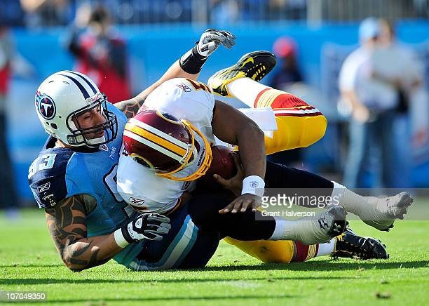 Jason Babin of the Tennessee Titans sacks quarterback Donovan McNabb of the Washington Redskins during the first half at LP Field on November 21 2010...