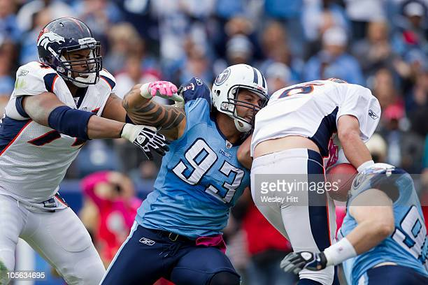 Jason Babin of the Tennessee Titans tackles Kyle Orton of the Denver Broncos at LP Field on October 3 2010 in Nashville Tennessee The Broncos...