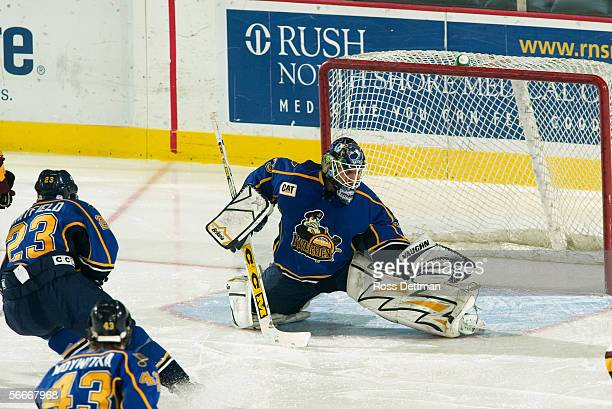 Jason Bacashihua of the Peoria Rivermen makes a save against the Chicago Wolves at Allstate Arena on December 11 2005 in Rosemont Illinois The Wolves...