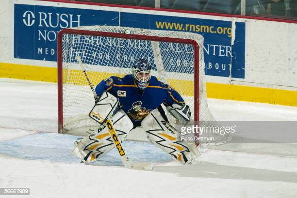 Jason Bacashihua of the Peoria Rivermen tends goal against the Chicago Wolves at Allstate Arena on December 11 2005 in Rosemont Illinois The Wolves...