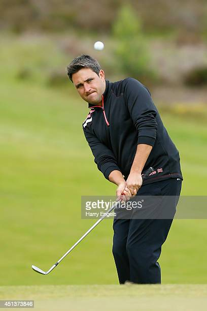 Jason Barnes of England chips at the thirteenth on day three of the 2014 Scottish Hydro Challenge hosted by MacDonald Hotels Resorts at Spey Valley...