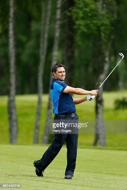 Jason Barnes of England hits off the fairway on day four of the 2014 Scottish Hydro Challenge hosted by Macdonald Hotels Resorts at Spey Valley Golf...