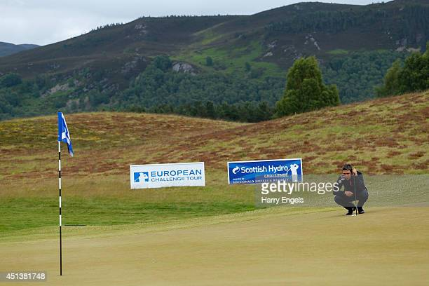 Jason Barnes of England lines up a putt at the fifteenth on day three of the 2014 Scottish Hydro Challenge hosted by MacDonald Hotels Resorts at Spey...