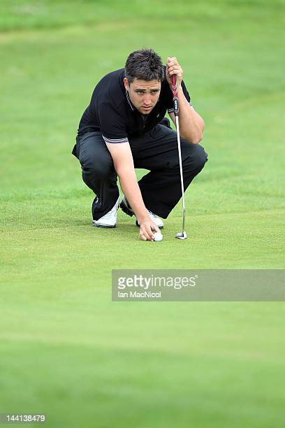Jason Barnes of England lines up a putt during the Allianz Challenge de France Day One at Golf Blue Green de Pleneuf Val Andre Golf Course on May 10...