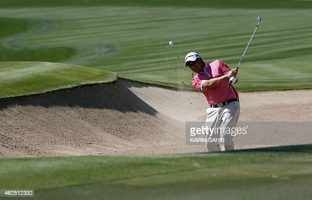 Jason Barnes of England plays a shot during the second round of the 2015 Omega Dubai Desert Classic on January 30 2015 in Dubai United Arab Emirates...